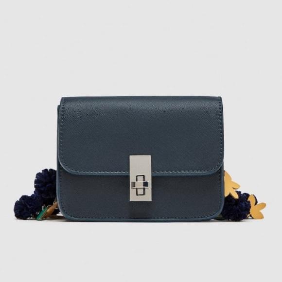 Zara Handbags - Zara navy blue crossbody bag with strap details